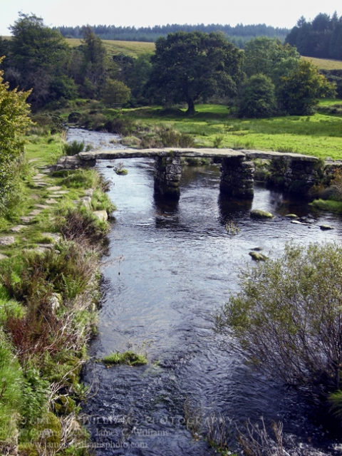"Built in 13th Century, this is an ancient ""clapper"" bridge, over the East Dart River, at Postbridge, Devon."