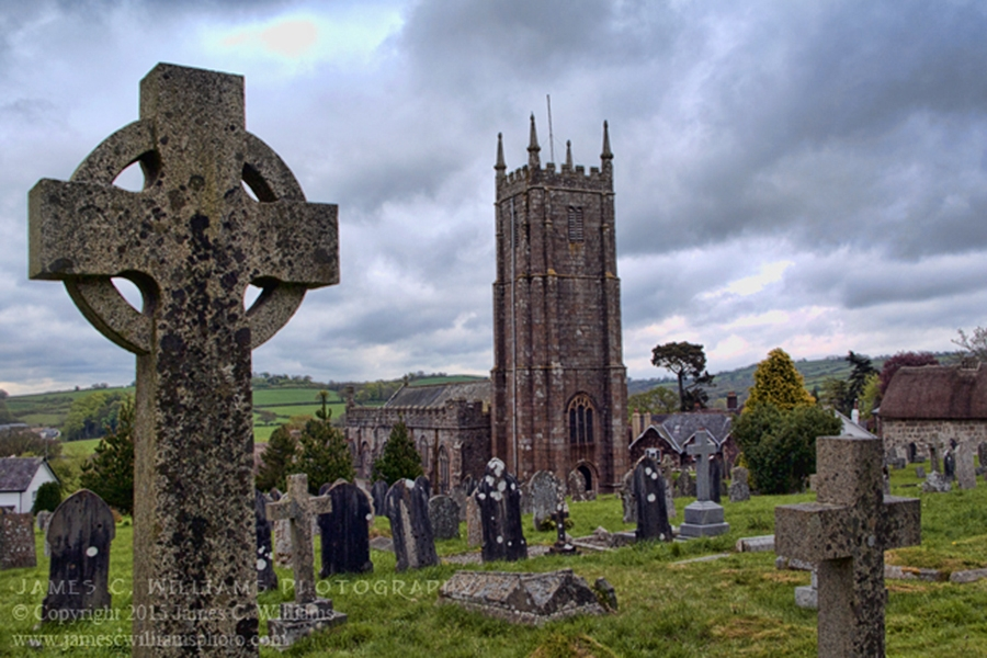 View through the churchyard of the beautiful church of St. Andrews, South Tawton, Devon. Shot in 2010; processed for final print 2015.