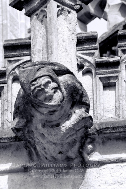 A hooded figure (grotesque) on exterior of Wells Cathedral. Shot in 2010, final edit processed 2015. James C. Williams Photography © Copyright 2015 James C. Williams www.jamescwilliamsphoto.com