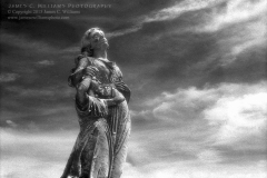 She Is In The Sky, Green Lawn Cemetery, Columbus, OhioInfrared Film Photograph; shot 2005, scanned and edited for final process 2006.James C. Williams Photography© Copyright 2015 James C. Williamswww.jamescwilliamsphoto.com